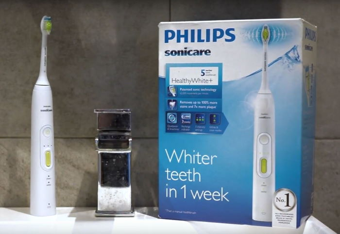 philips sonicare healthy white 5 series rechargeable sonic toothbrush on bathroom sink